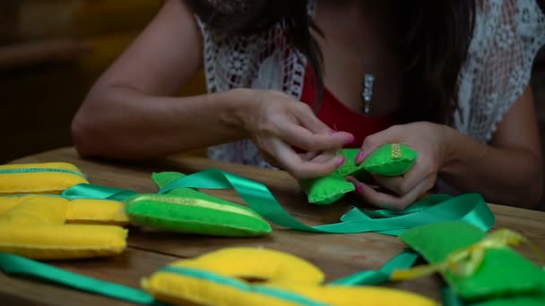 Handmade girls sewing letters of felt
