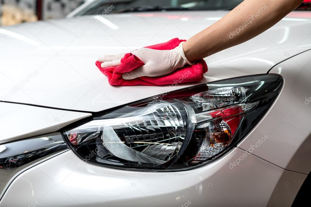 Car Detailing Prices >> Car detailing series : Worker waxing white car — Stock Photo © kunksy.gmail.com #103206614