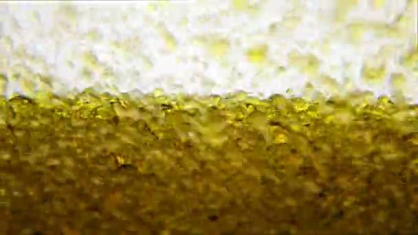 Gocce di liquido bolle dorate