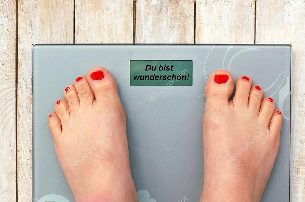 Feet On Scales With Text You Are Beautiful In German Language