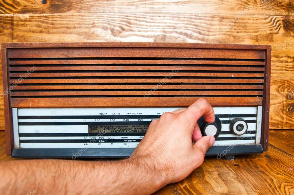 Hand tuned old radio. wooden background