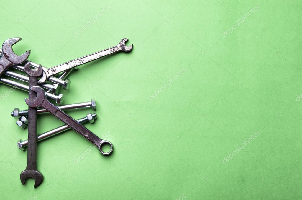 Set of brilliant nut keys on a green background