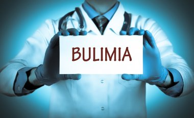 Doctor keeps a card with the name of the diagnosis - bulimia