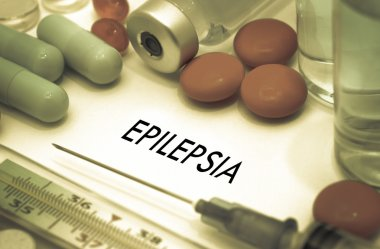 Epilepsia. Treatment and prevention of disease. Syringe and vaccine. Medical concept. Selective focus