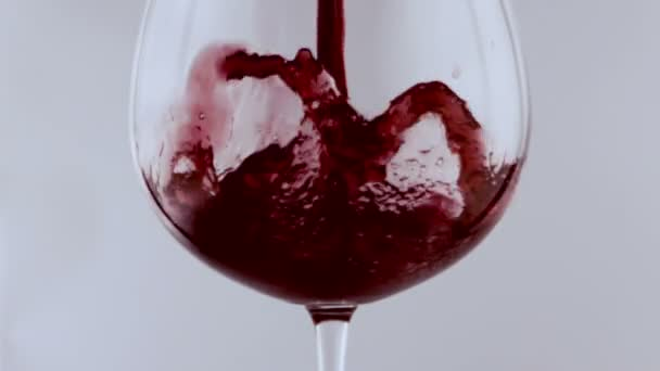 glass of red wine in slow motion