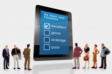 Online we want your feedback  survey on a digital tablet