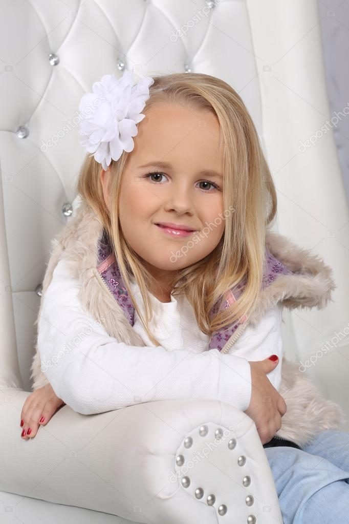 Portrait Of A Cute Little Blond Girl With Long Hair Stock Photo