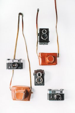 Four vintage retro photo cameras. Flat lay