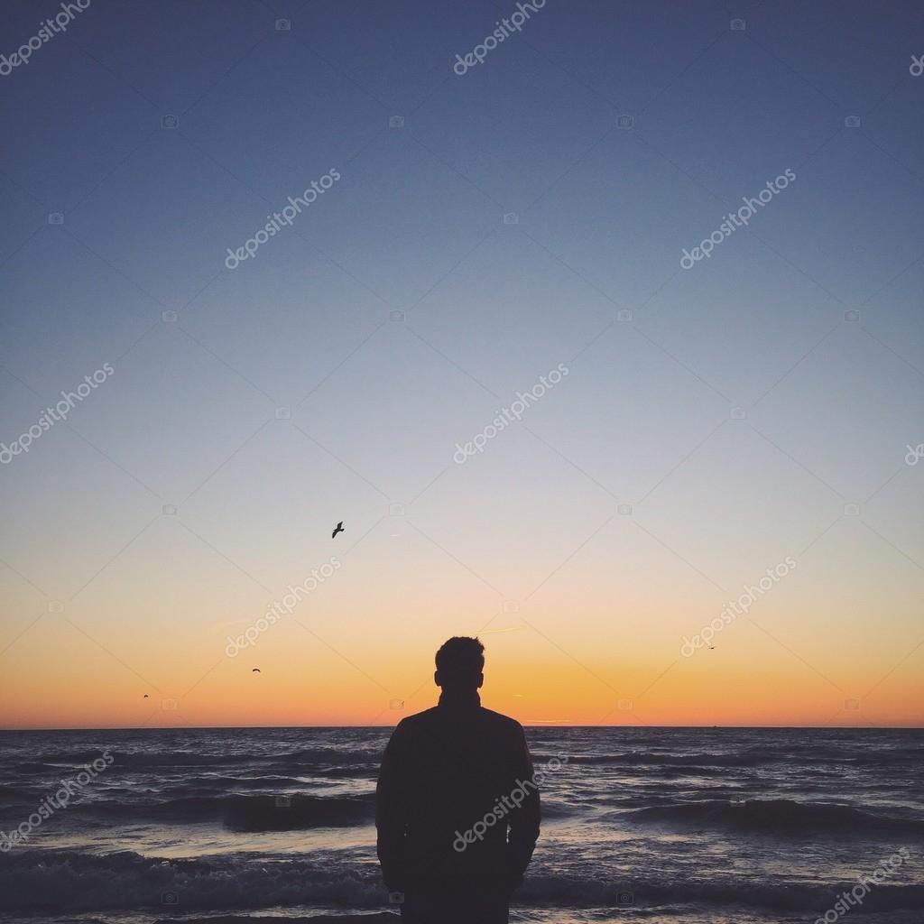 A man staying near the ocean