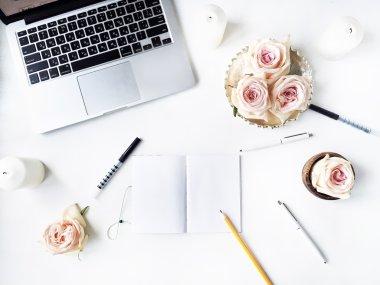 Workspace with pen, pencil, laptop