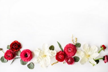 Pink and red roses or ranunculus, white tulips and green leaves
