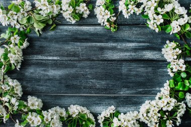 Wreath frame with white flowers and branches isolated on old retro wooden table background. flat lay, overhead view, top view stock vector