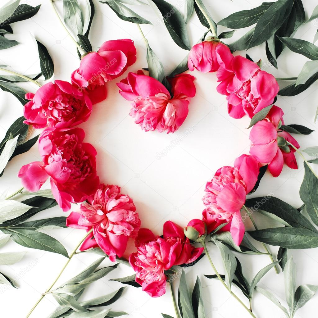 heart wreath frame with peonies flat lay top view photo by maximleshkovich