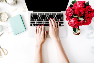 Workplace with laptop, girl's hands