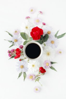 Cup of coffee with roses and flowers.