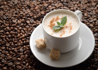 white coffee cup with mint