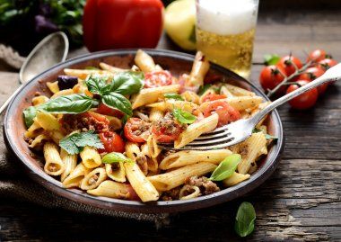 pasta with meat and basil on a plate