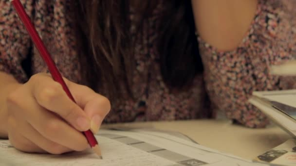 Woman studies and she thinks about answer of quiz