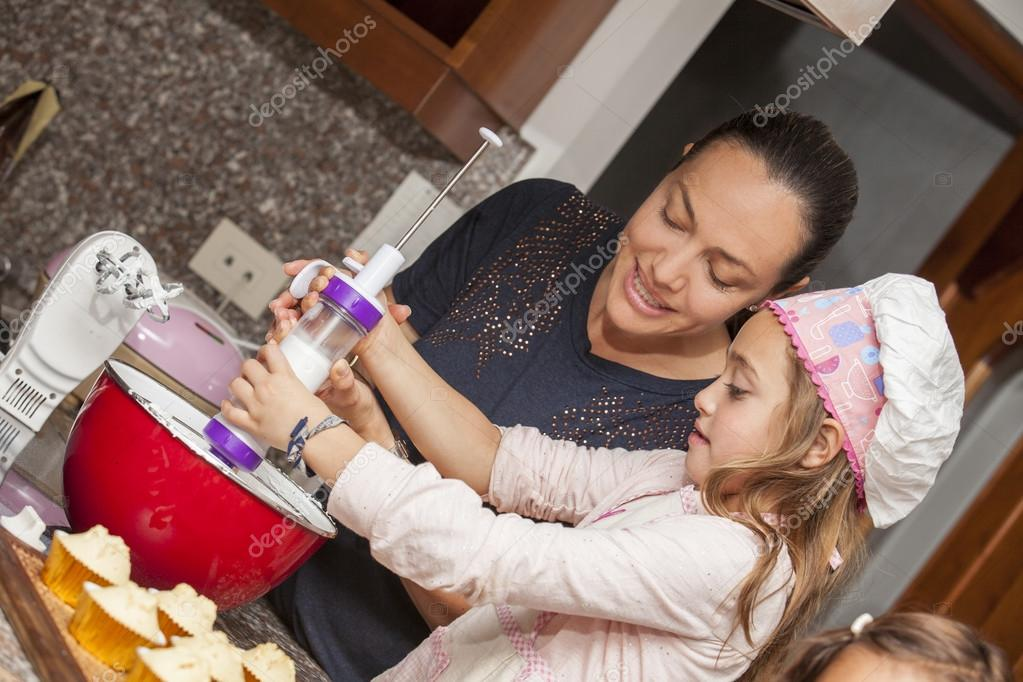 decorating cupcakes with mom photo by anamejia18 - Woman Decorating Cupcakes