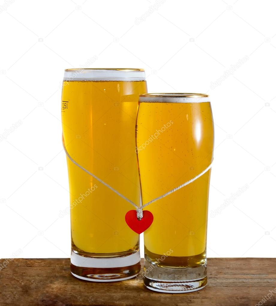 two glasses of beer for lovers isolated on white