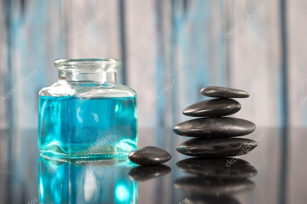 Beautiful spa composition hot stone and essential oil
