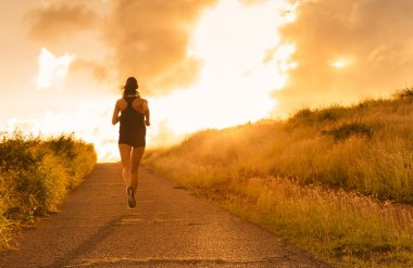 Female running at sunset.