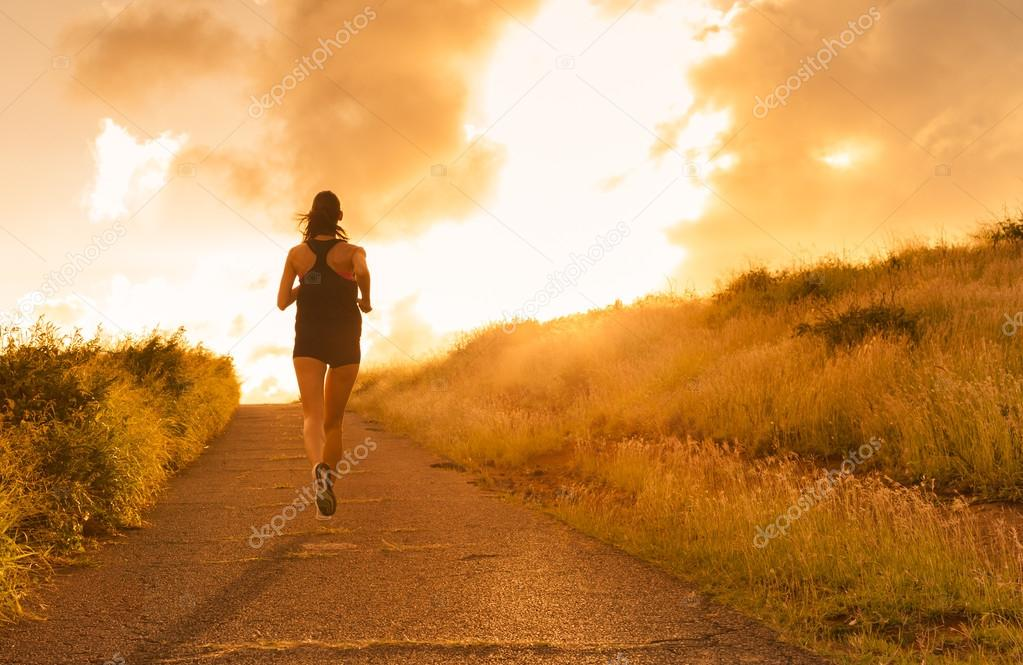 Female running at sunset.