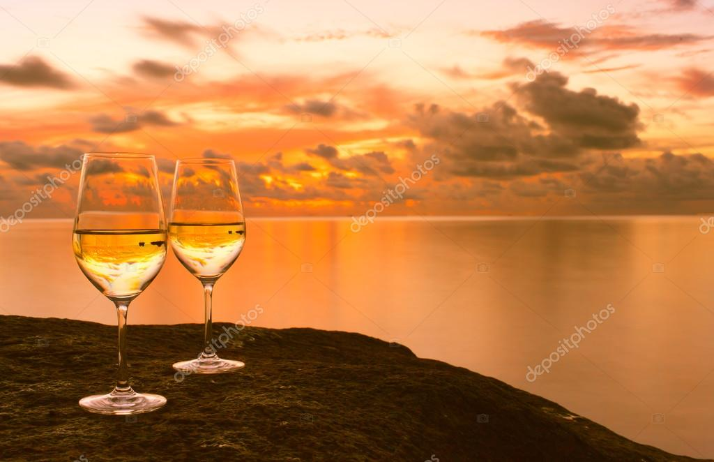 Wineglasses with ocean background