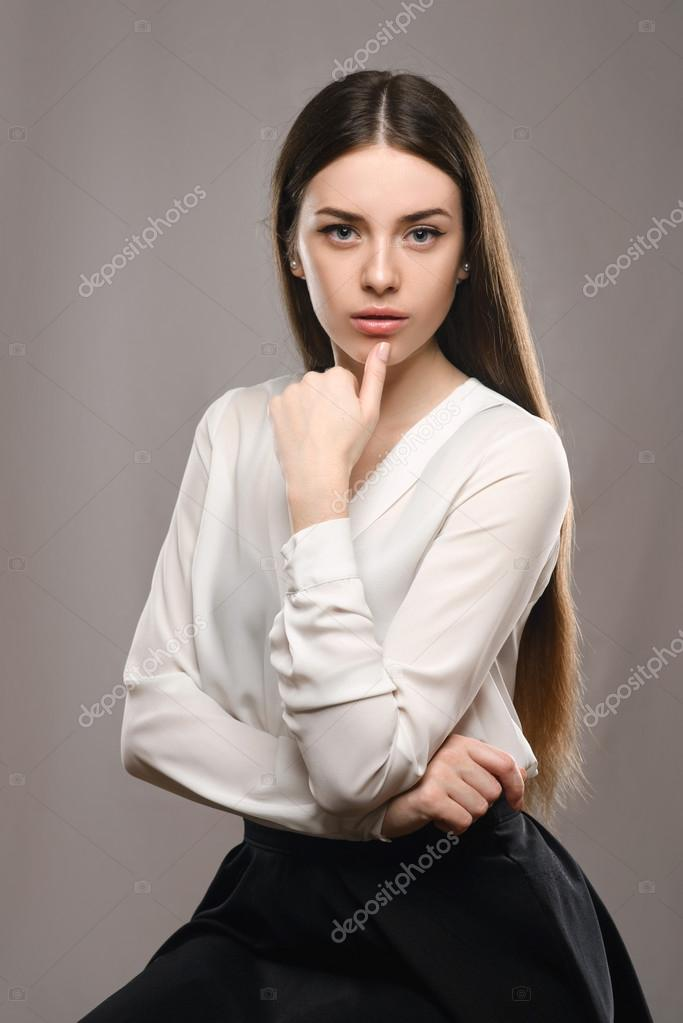 Portrait Beautiful Girl In White Blouse And Black Skirt Stock