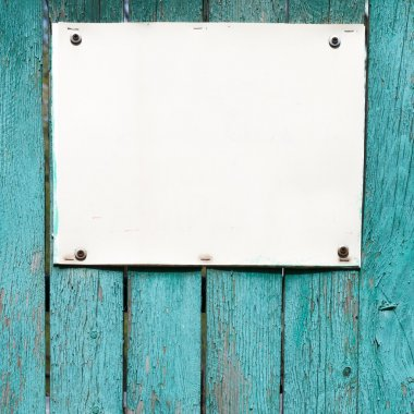 empty white board over wood wall background. Place for text.