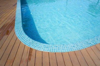 swimming pool with fake wood flooring