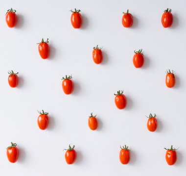 Cherry tomatoes pattern on white background