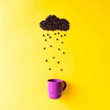 Coffee beans in shape of rainy cloud with cup.