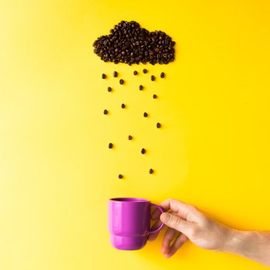 Coffee beans in shape of rainy cloud with purple cup on yellow background. Weather concept. stock vector
