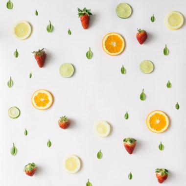 Colorful pattern made of citrus fruits and strawberries. Flat la