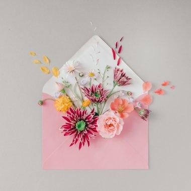 Pink envelope full of various flowers