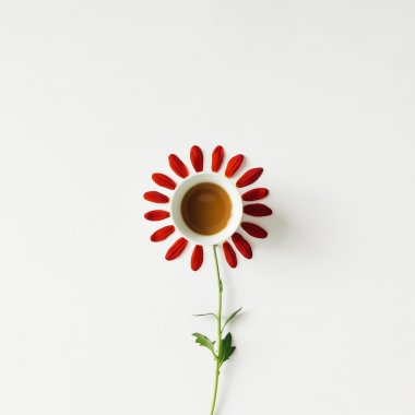 Coffee cup and flower petals.