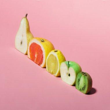 Various fruits sliced in half.