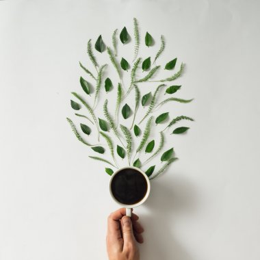 Coffee cup with leaves