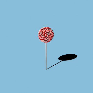 Lollipop on blue background.