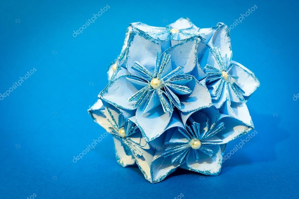 Blue origami flower ball on the blue background stock photo blue origami flower ball on the blue background stock photo mightylinksfo