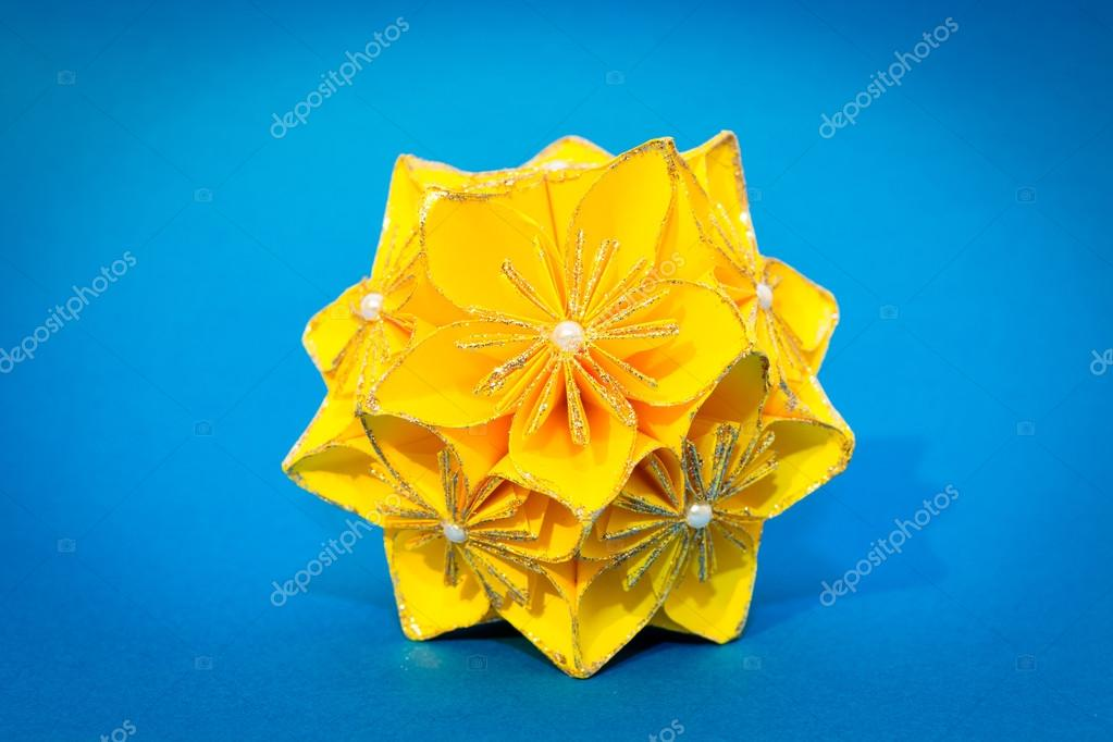 Yellow Origami Flower Ball On The Blue Background Stock Photo