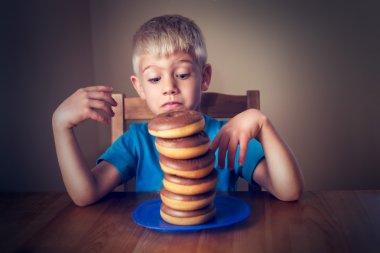 Young Boy Looking At Donuts stock vector