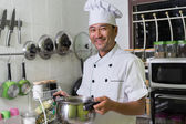 Fotografie Smiling asian chef