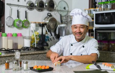 Smiling asian chef