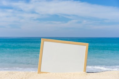 White board on the beach