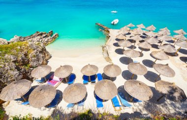 Umbrellas and deckchairs on the beach