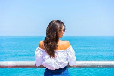 woman looking on sea