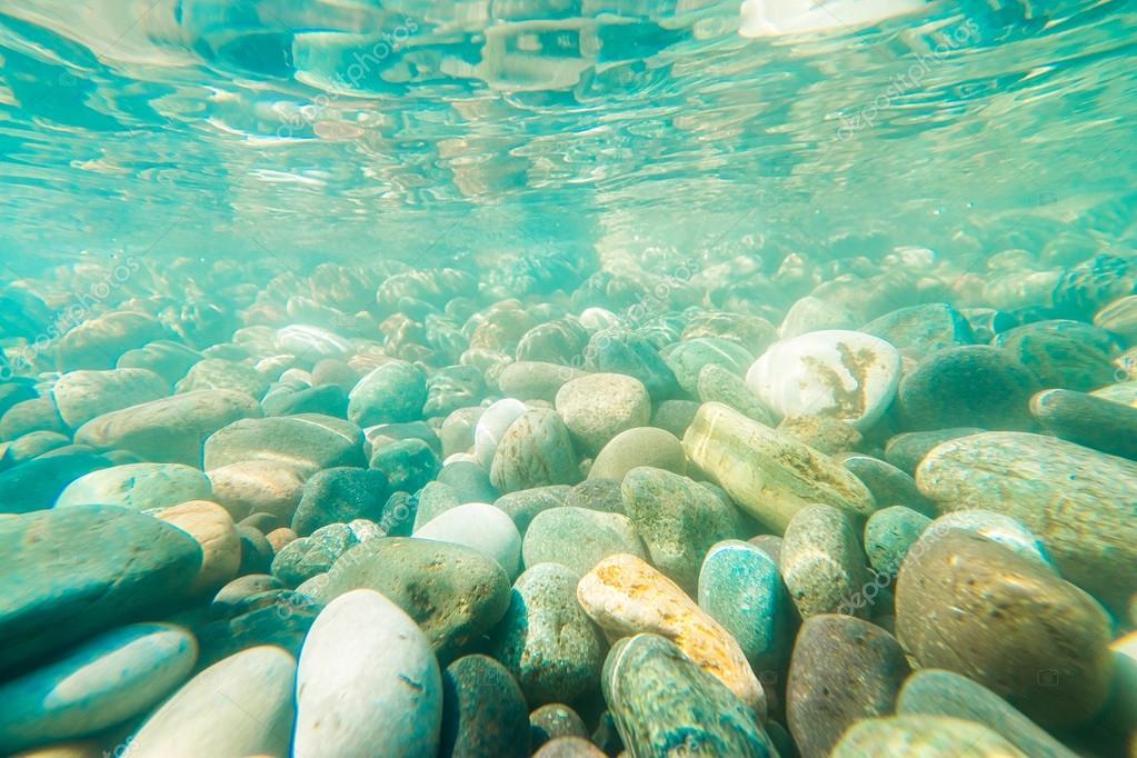 Underwater light on a rocky seafloor