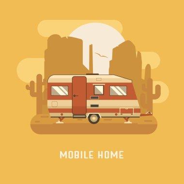 Mobile home on wild desert landscape.